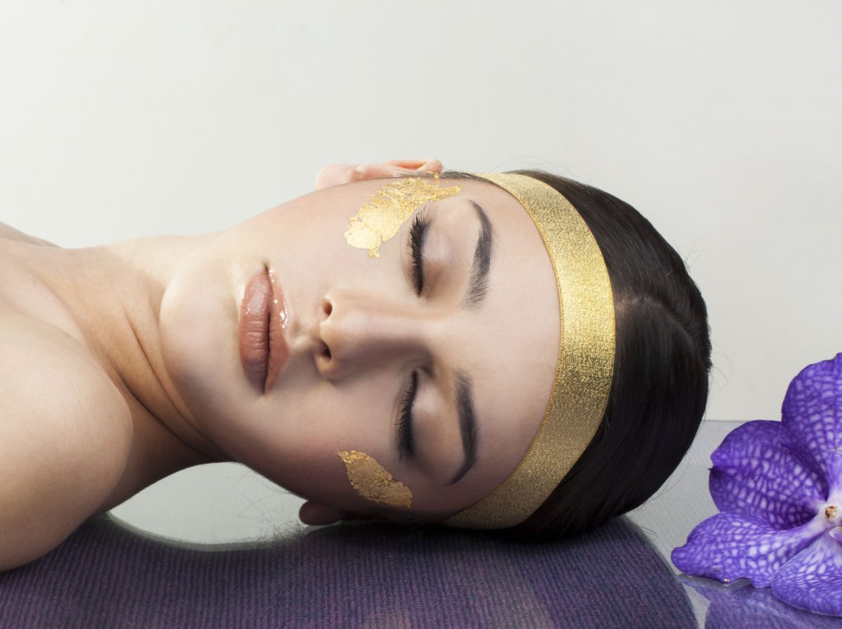 Woman with Gold Leaf Facial