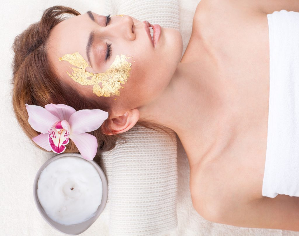 Woman in Spa with Gold Collagen Eye Mask