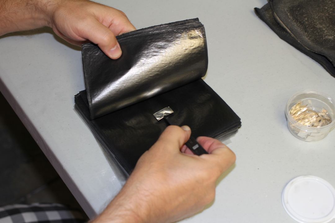 Metal is cooled, and cut into squares, then put between black sheets