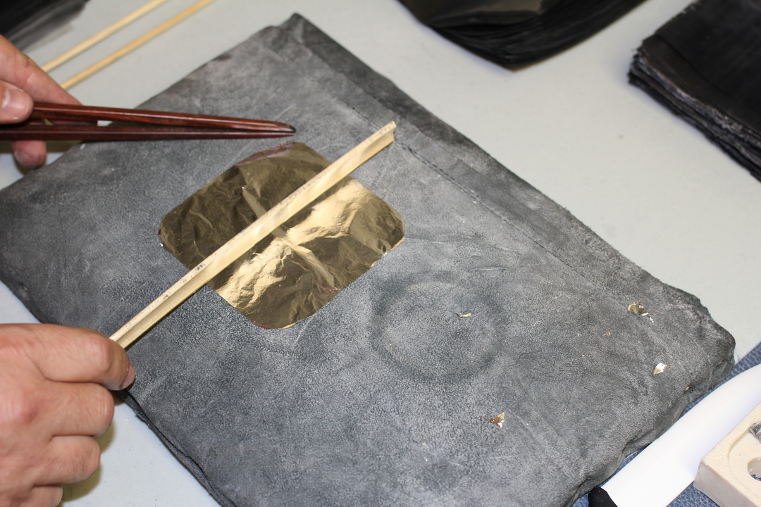 Flattened Gold Sheet is cut by sharpened bamboo, as metal knives will not work.