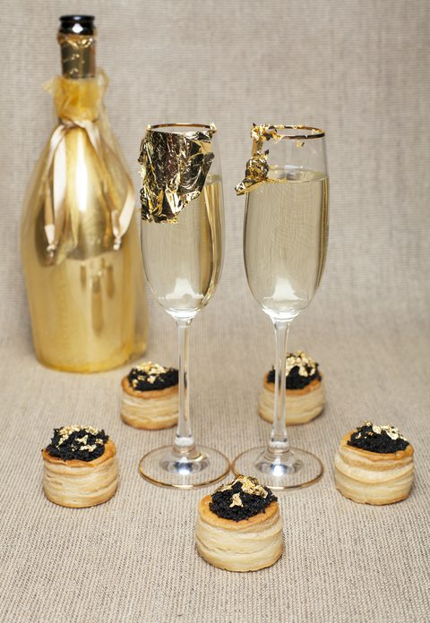 Gold Leaf Flakes on Champagne Flutes and Caviar