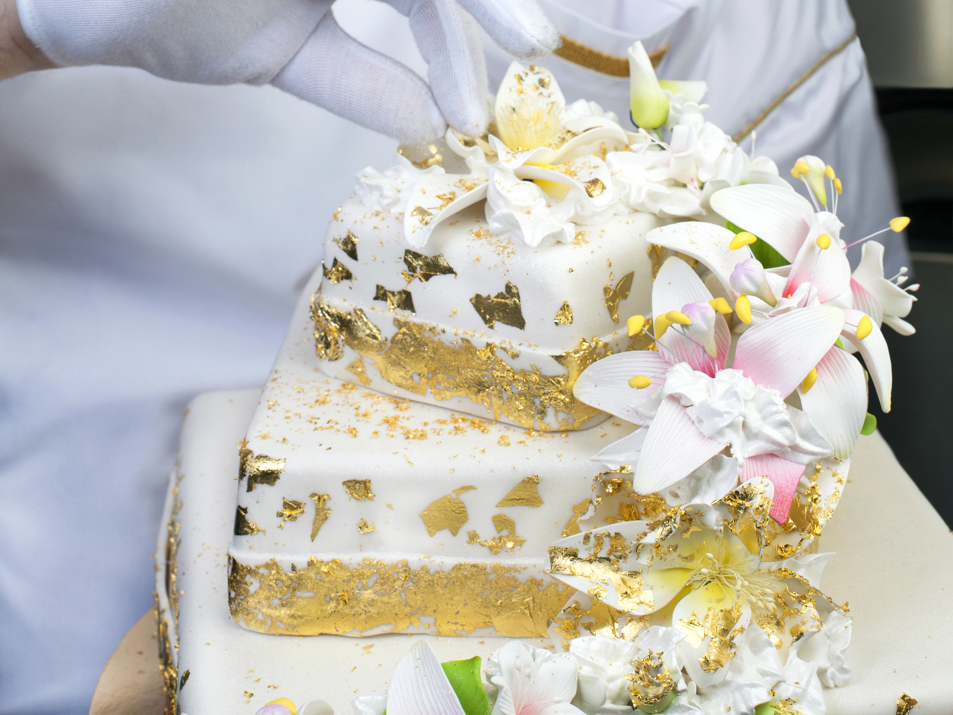Large vanilla cake with edible gold flakes.