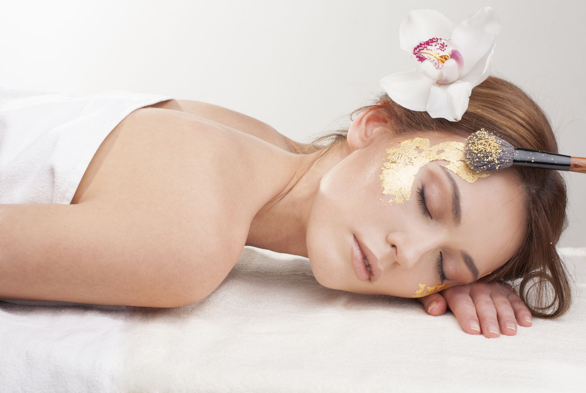 Luxury relaxation with gold leaf facial mask.