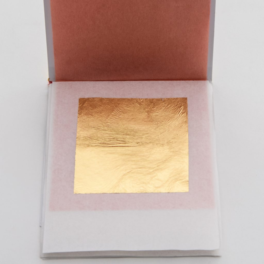 A gold leaf sheet in a booklet.