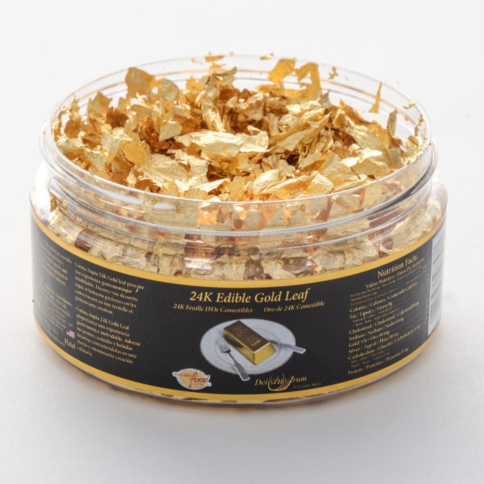 Edible gold flakes in jar container.