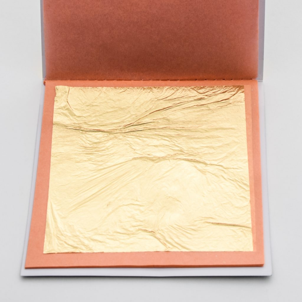 Edible gold leaf sheets in loose booklet.